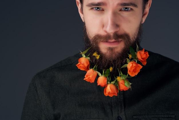 Portret van een man kapsel mode bloemen emoties studio levensstijl