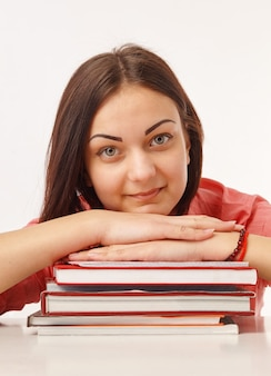 Portret van een mooie student met boeken