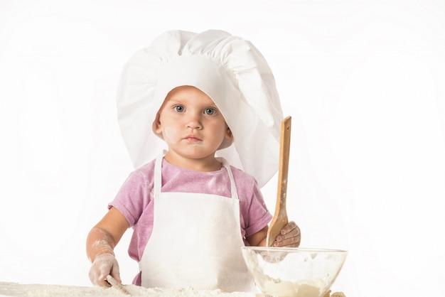 Portret van een schattig klein kind in een koksmuts