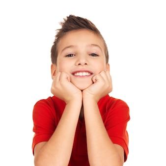 Portret van een schattige gelukkige jongen met een mooie glimlach. foto op witte ruimte