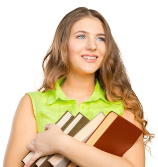 Portret van een vrolijke vrouwelijke tiener met een boek