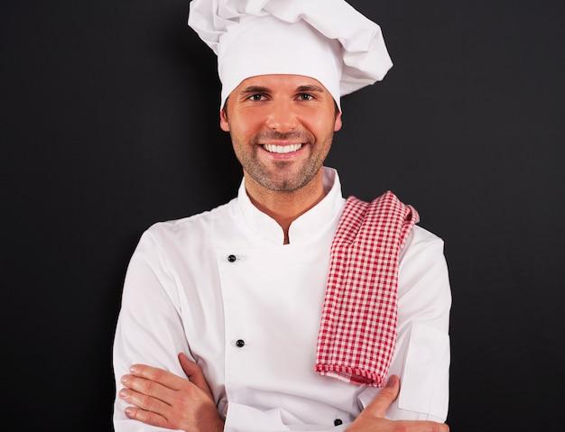 Portret van knappe kokende chef-kok