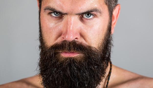 Portret van mannelijkheid. sexy look van man. hipster man met baard, snor.