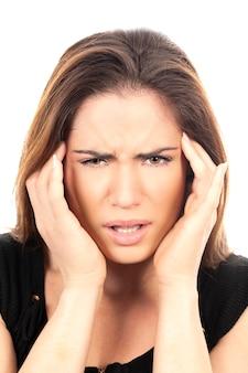 Portret van mooie vrouw met hoofdpijn
