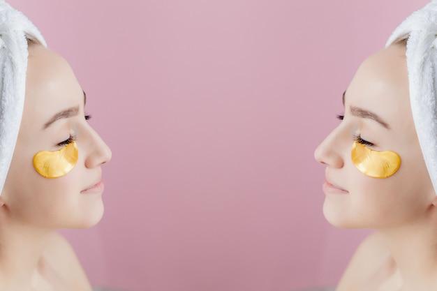 Portret van schoonheidsvrouw met ooglapjes op roze. vrouw schoonheid gezicht met masker onder de ogen. mooie vrouw met natuurlijke make-up en gouden cosmetica collageenpleisters op frisse gezichtshuid