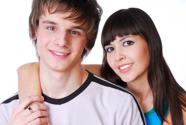 Portret van twee mooie jonge volwassen jongen en meisje