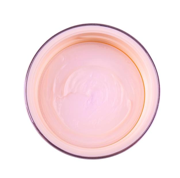 Pot met een vrouwelijke gezichtscrème geïsoleerd op een witte achtergrond