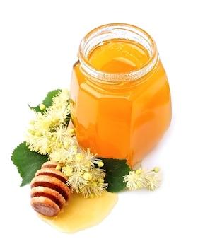 Pot met honing met linde op wit