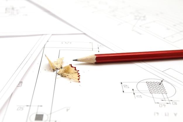 Potlood en blauwdrukken voor ontwerptekeningen van een architect