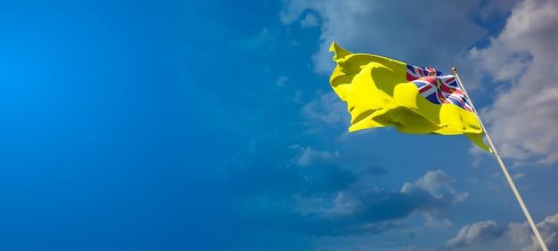 Prachtige nationale vlag van niue met lege ruimte op brede achtergrond met plaats voor tekst 3d-illustraties.