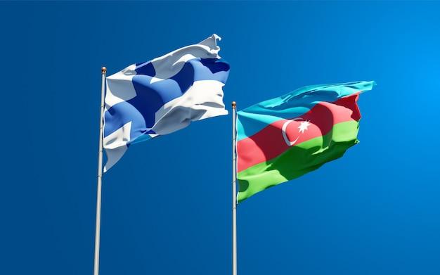 Prachtige nationale vlaggen op de hemelachtergrond