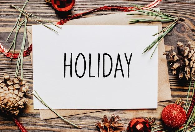 Prettige kerstdagen en vrolijk nieuwjaar concept notitieboekje met tekst vakantie