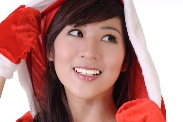 Pretty christmas vrouw van aziatische, close-up portret op wit.