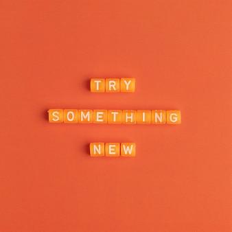 Probeer iets nieuws kralen bericht typografie
