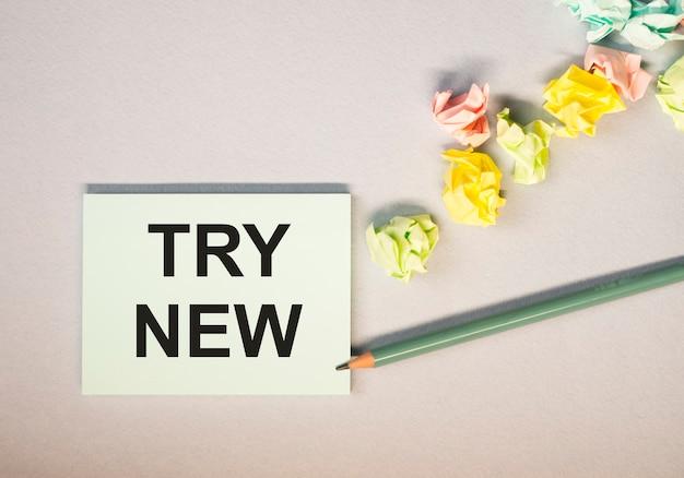 Probeer nieuwe tekst, bericht op papier. motivatie in leren en zaken.