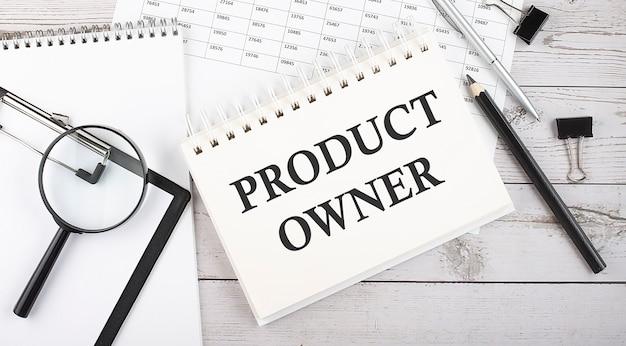 Product eigenaar . tekst geschreven op het kladblok met office-hulpprogramma's en documenten.