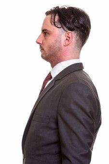 Profiel te bekijken van jonge zakenman in pak