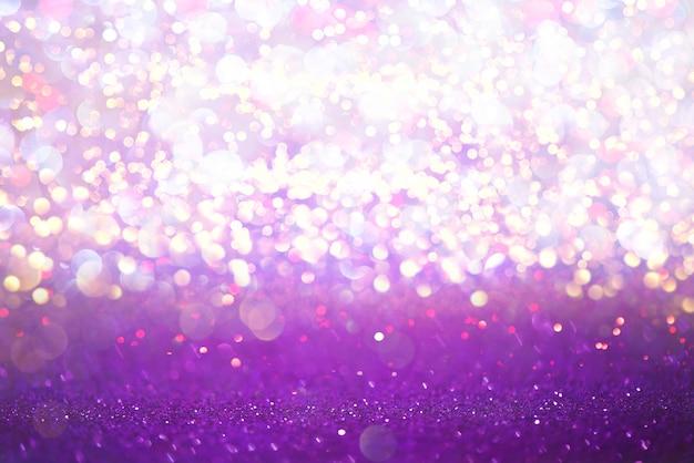 Purper schitter de bokeh abstracte achtergrond van de lichtentextuur. defocused