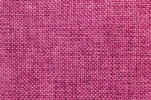 Purpere textielclose-up als achtergrond. structuur van de stoffenmacro
