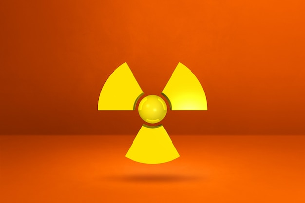 Radioactief symbool geïsoleerd op een oranje studio
