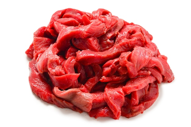 Rauwe kalfsvlees stukken achtergrond. rundvlees stroganoff.