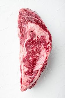 Rauwe rib eye biefstuk gemarmerd vlees geheel gesneden set