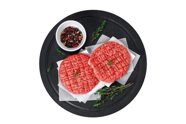 Rauwe rundergehaktpasteitjes voor hamburgers rauw vlees hamburgers runderkoteletten