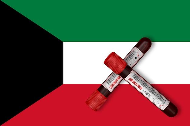Reageerbuisjes met de inscriptie 2019-ncov op de achtergrond van de vlag van koeweit. 3d-rendering