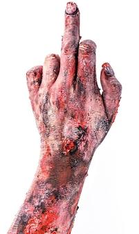 Realistische zombie of ondode hand, met obsceen, vulgair gebaar, uitgestrekte middelvinger