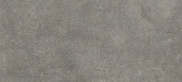 Rechthoekige grijze achtergrond in de vorm van gehouwen steen, graniet of marmer. voor vloer of wand