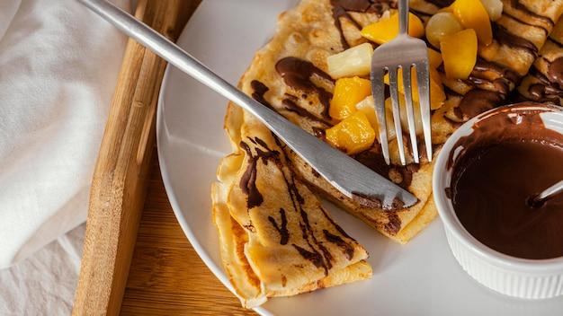 Regeling met pannenkoeken en chocolade