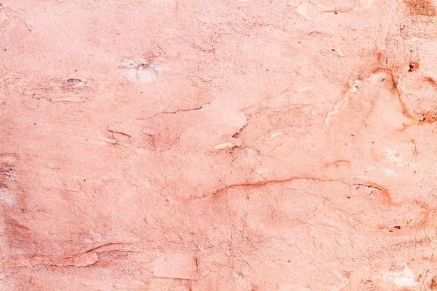 Regeling van roze geschilderde stenen om muren te maken