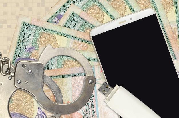 Rekeningen van 1000 sri lankaanse roepies en smartphone met politiehandboeien