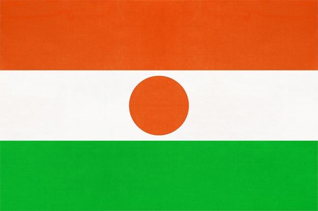 Republiek niger nationale textiel vlag textiel achtergrond. symbool van wereld afrikaans land.