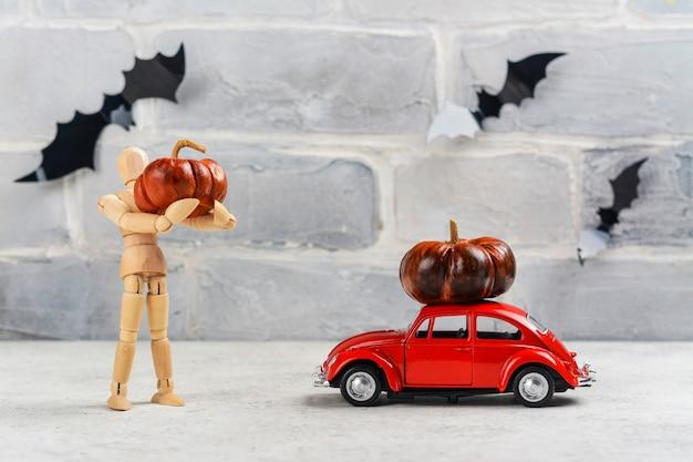 Retro auto en pompoen erop