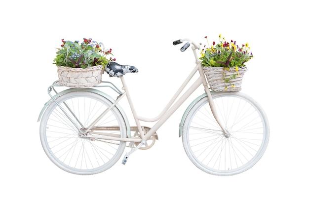 Retro fiets met bloemenmanden die op witte achtergrond worden geïsoleerd