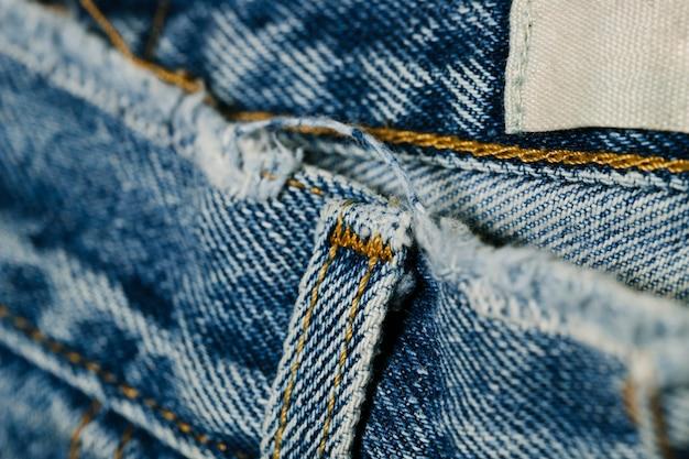 Riemlus van blauwe jeansclose-up