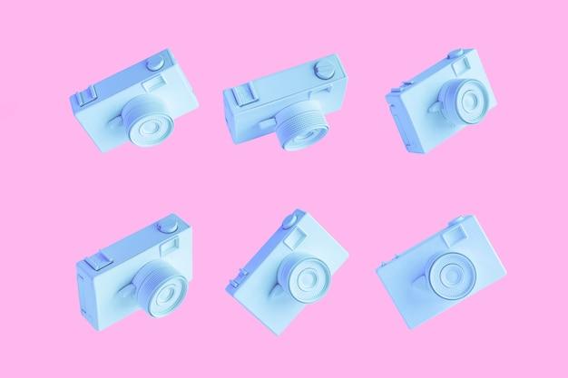 Rij van blauw geschilderde camera's tegen roze achtergrond