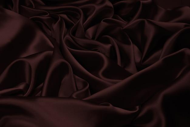 Rijke en luxe rode zijde stof textuur achtergrond. bovenaanzicht.