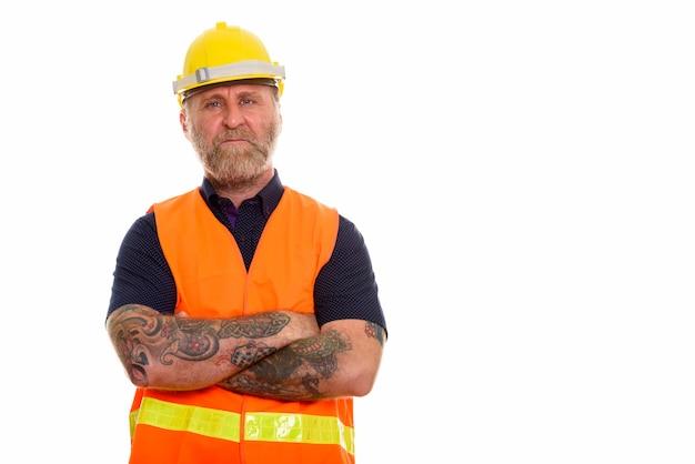Rijpe bebaarde man bouwvakker met hand tatoeages met ar