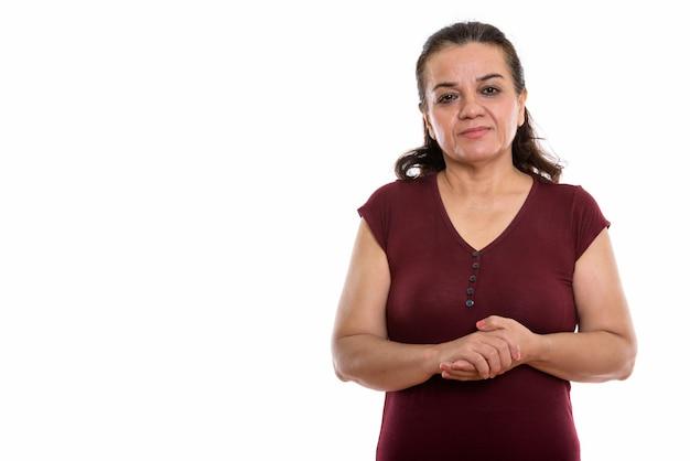 Rijpe perzische vrouw met handen in elkaar