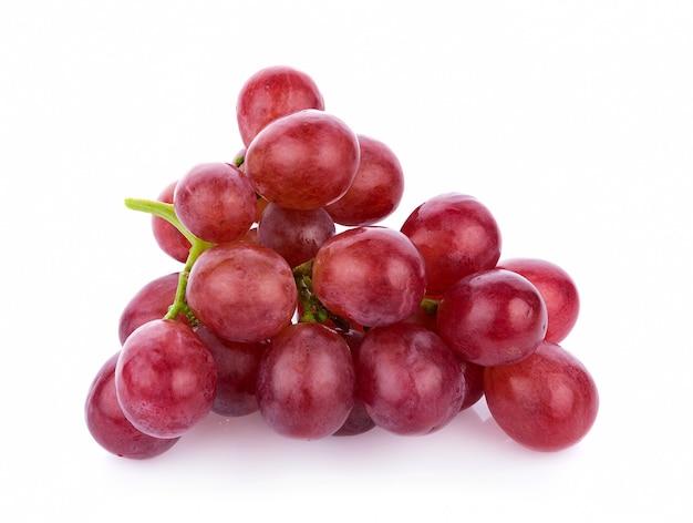 Rijpe rode druif op witte muur