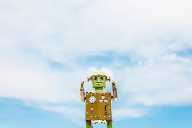 Robot toy imagination retro stijl cloudscape sky concept