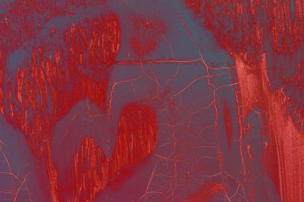 Rode abstracte grungetextuur met verfstrepen en barsten