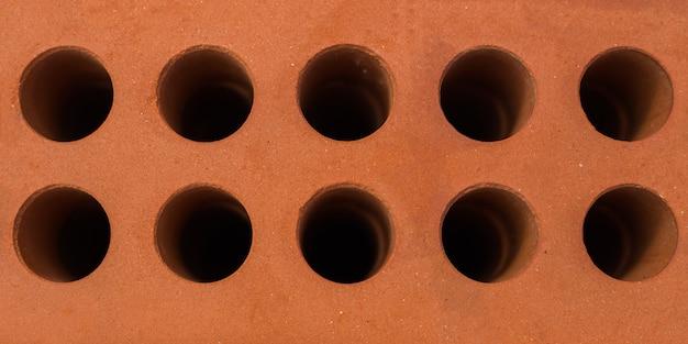 Rode bakstenen blok close-up. textuur