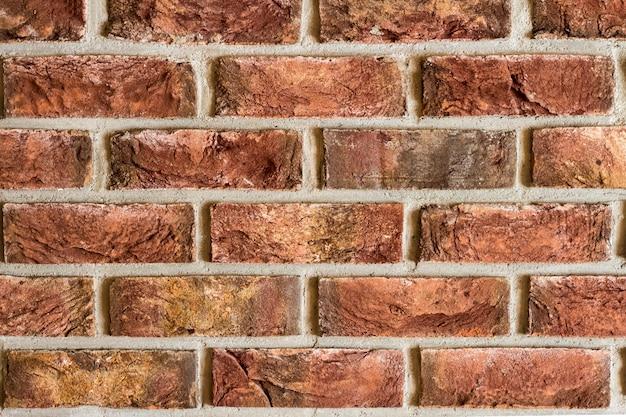 Rode bakstenen muur fragment achtergrondstructuur close-up