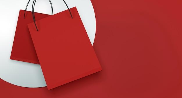 Rode boodschappentas op oranje en rode achtergrond Premium Foto