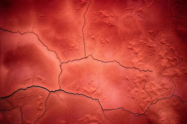 Rode cement textuur, betonnen oppervlak van de muur, gekleurde achtergrond