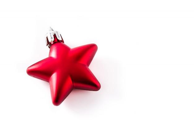 Rode de sterdecoratie van kerstmis die op wit wordt geïsoleerd.
