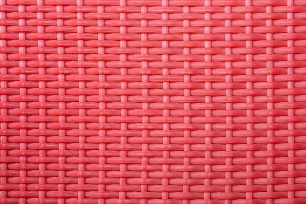 Rode de textuurachtergrond van het weefsel plastic netwerk